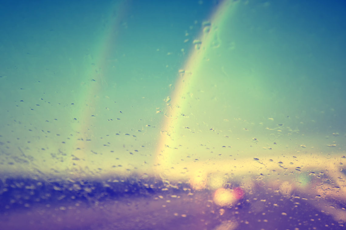 A double rainbow through a rainy windshield. But what does it MEAN?